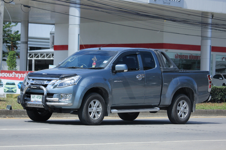 8 12: CHIANGMAI, THAILAND -NOVEMBER 12 2015:  Private Pickup car, Isuzu Dmax. Photo at road no 121 about 8 km from downtown Chiangmai, thailand.