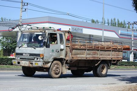 truckload: CHIANGMAI, THAILAND -NOVEMBER 17 2015:  Truck of Thailand Forest Industry Organization. Photo at road no 121 about 8 km from downtown Chiangmai, thailand. Editorial