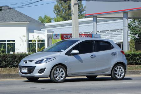 2 november: CHIANGMAI, THAILAND -NOVEMBER 22 2015:  Private Eco car, Mazda 2. Photo at road no 121 about 8 km from downtown Chiangmai, thailand.