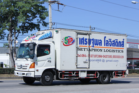 transportation company: CHIANGMAI, THAILAND -NOVEMBER 23 2015: Container truck of Settaphon Logistics Transportation company. Photo at road no.121 about 8 km from downtown Chiangmai, thailand.