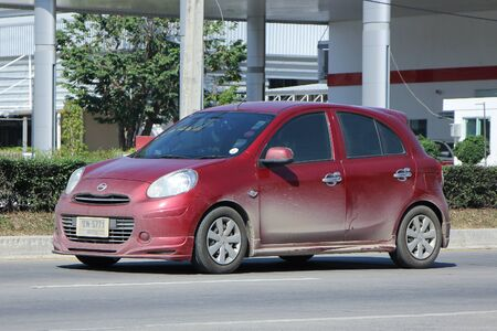 nissan: CHIANGMAI, THAILAND -NOVEMBER 28 2015:  Private Eco car, Nissan March. Photo at road no 121 about 8 km from downtown Chiangmai, thailand.