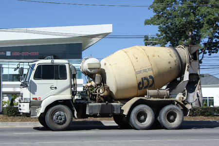 concrete truck: CHIANGMAI, THAILAND -DECEMBER 6 2015: Concrete truck of Chiangmai Concrete product company. Photo at road no.121 about 8 km from downtown Chiangmai, thailand. Editorial
