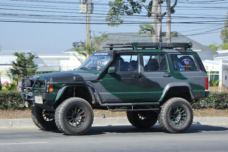 8 12: CHIANGMAI, THAILAND -DECEMBER 12 2015:  Private jeep car. Photo at road no.121 about 8 km from downtown Chiangmai, thailand.