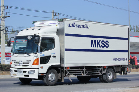 transportation company: CHIANGMAI, THAILAND -JANUARY 5 2016:  Container truck of MKSS Transportation company. Photo at road no.1001 about 8 km from downtown Chiangmai, thailand. Editorial