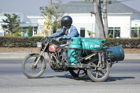 ngv: CHIANGMAI, THAILAND -JANUARY 5 2016:  Private Motorcycle for delivery gas lpg to home. Photo at road no 121 about 8 km from downtown Chiangmai, thailand. Editorial