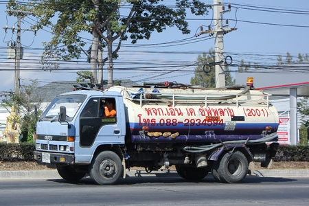 service industry: CHIANGMAI, THAILAND -JANUARY 15 2016: Private of Sewage truck. Photo at road no.121 about 8 km from downtown Chiangmai, thailand.