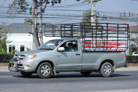 CHIANGMAI, THAILAND -JANUARY 19 2016:   Private Pickup car, Toyota Hilux. Photo at road no 121 about 8 km from downtown Chiangmai, thailand. Editorial