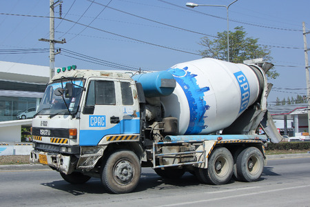 concrete truck: CHIANGMAI, THAILAND -FEBRUARY 2 2016:  Concrete truck of CPAC Concrete product company. Photo at road no.121 about 8 km from downtown Chiangmai, thailand. Editorial