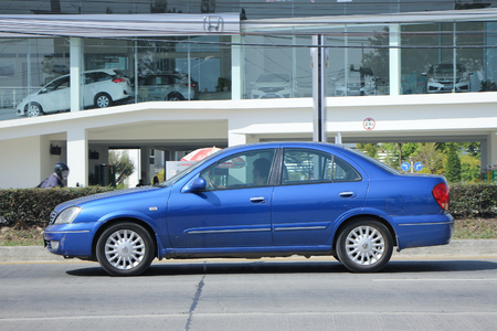 nissan: CHIANGMAI, THAILAND -FEBRUARY 2 2016:   Private car, Nissan Sunny. Photo at road no 121 about 8 km from downtown Chiangmai, thailand.