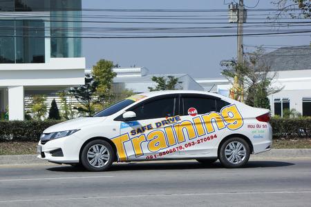 driving school: CHIANGMAI, THAILAND -FEBRUARY 2 2016:    Honda City of Save Drive Driving School. Photo at road no.1001 about 8 km from downtown Chiangmai, thailand. Editorial