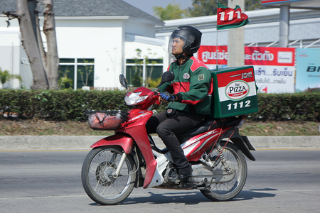 delivery box: CHIANGMAI, THAILAND -FEBRUARY 4 2016: Delivery service man ride a Motercycle of The Pizza Company. On road no.1001, 8 km from Chiangmai city.