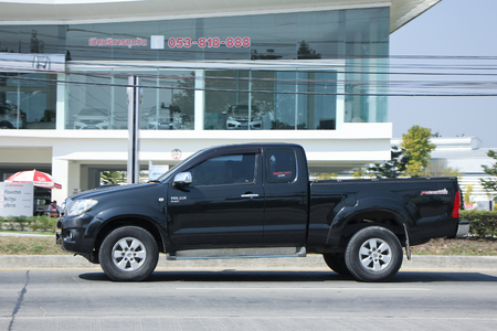 km: CHIANGMAI, THAILAND -FEBRUARY 4 2016:   Private Pickup car, Toyota Hilux. On road no.1001, 8 km from Chiangmai city.