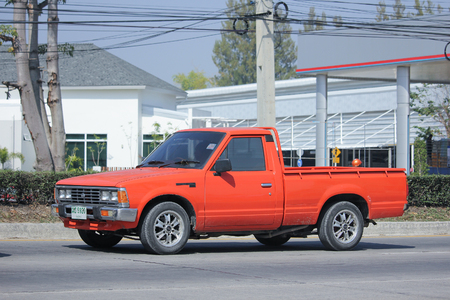 nissan: CHIANGMAI, THAILAND -FEBRUARY 8 2016:  Private old Pickup car, Nissan or Datsan 1500.  On road no.1001, 8 km from Chiangmai city. Editorial