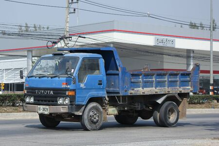 highway 6: CHIANGMAI, THAILAND -FEBRUARY 11 2016:  Private Toyota Dyna Dump Truck.   On road no.1001, 8 km from Chiangmai city.