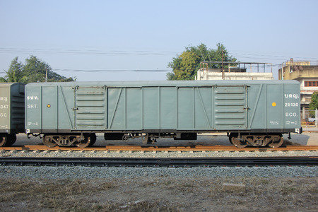 goods train: CHIANGMAI, THAILAND -FEBRUARY 13 2016:   Covered goods wagon, Container train. Photo at Chiangmai Train Station. Thailand. Editorial