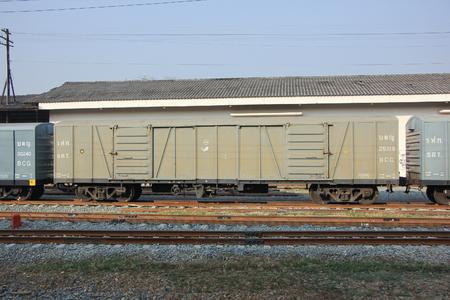 goods train: CHIANGMAI, THAILAND -FEBRUARY 13 2016:   Covered goods wagon, Container train. Photo at Chiangmai Train Station. Thailand. Editorial