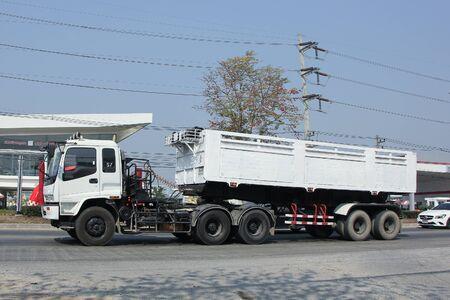 truckload: CHIANGMAI, THAILAND -FEBRUARY 16 2016:   Trailer dump truck of Tanachai company.   On road no.1001, 8 km from Chiangmai city.