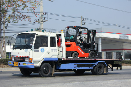 petrolium: CHIANGMAI, THAILAND -FEBRUARY 16 2016:    Truck with Toyota Forklift truck. TCP Petrolium Company.  On Truck on road no.1001, 8 km from Chiangmai city. Editorial