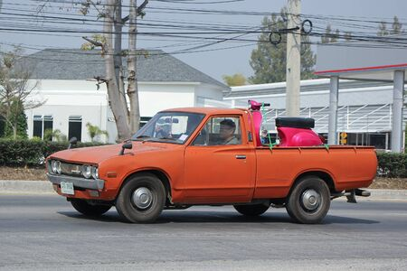 nissan: CHIANGMAI, THAILAND -FEBRUARY 19 2016: Private old Pickup car, Nissan or Datsan 1500.  On road no.1001, 8 km from Chiangmai city.