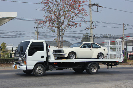 CHIANGMAI, THAILAND -FEBRUARY 21 2016:   Private Slide up tow truck for emergency car move.  On road no.1001, 8 km from Chiangmai city. Éditoriale