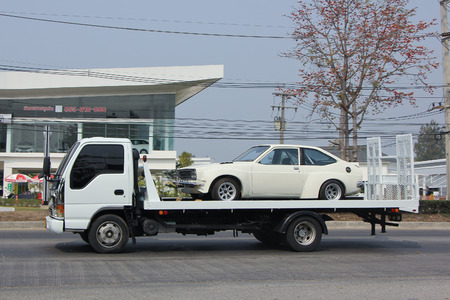 CHIANGMAI, THAILAND -FEBRUARY 21 2016: Private Slide up tow truck for emergency car move. On road no.1001, 8 km from Chiangmai city.