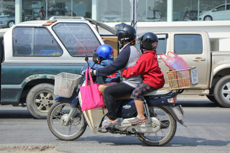 HONDA: CHIANGMAI, THAILAND -FEBRUARY 22 2016:   Private Honda Super Cub Motorcycle.   On road no.1001, 8 km from Chiangmai city.