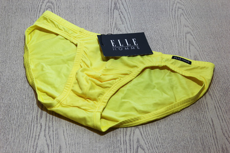 public company: CHIANGMAI, THAILAND -MARCH  25 2016: Product shot of Elle Homme, Yellow bikini Underwear from Tactel Fabric mix Spandex. Elle Homme in thailand made and sale by I.C.C. International Public Company.