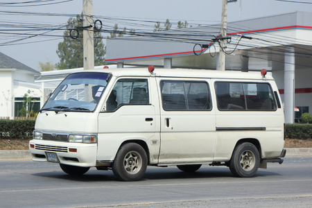 nissan: CHIANGMAI, THAILAND -FEBRUARY 25 2016:   Private Nissan Urvan Van for rent to Travel. Photo at road no.1001 about 8 km from downtown Chiangmai, thailand.