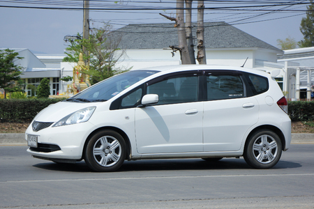 automobile door: CHIANGMAI, THAILAND -FEBRUARY 27 2016:   Private car  Honda Jazz.  five door hatchback automobile from Honda Japanese manufacturer. Photo On road no.1001, 8 km from Chiangmai city. Editorial
