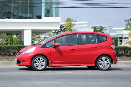 HONDA: CHIANGMAI, THAILAND -FEBRUARY 27 2016:   Private car  Honda Jazz.  five door hatchback automobile from Honda Japanese manufacturer. Photo On road no.1001, 8 km from Chiangmai city. Editorial