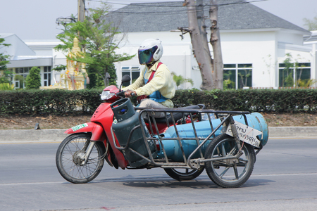 ngv: CHIANGMAI, THAILAND -MARCH 3 2016:   Private Motorcycle for delivery gas lpg to home. Photo at road no 121 about 8 km from downtown Chiangmai, thailand.