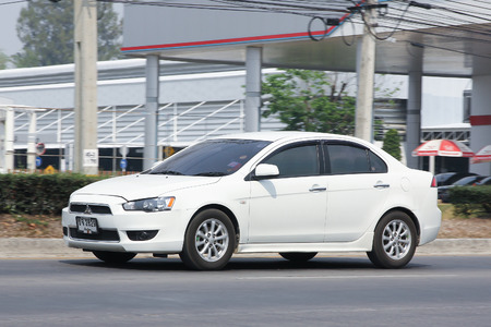 CHIANGMAI, THAILAND -MARCH 10 2016:  Private car, Mitsubishi Lancer. On Truck on road no.1001, 8 km from Chiangmai city. Editorial