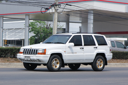 cherokee: CHIANGMAI, THAILAND -MARCH 10 2016:  Private jeep Grand Cherokee car. Photo at road no.121 about 8 km from downtown Chiangmai, thailand. Editorial