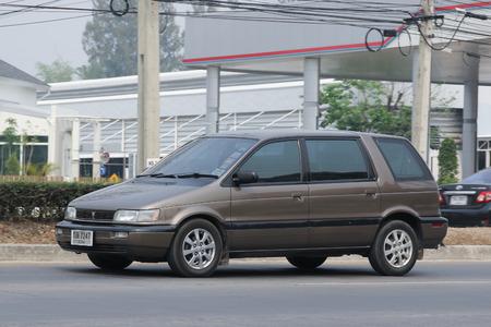 mpv: CHIANGMAI, THAILAND -MARCH 11 2016:  Private Mpv car, Mitsubishi Space Wagon. Photo at road no 121 about 8 km from downtown Chiangmai, thailand.
