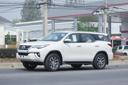 8 12: CHIANGMAI, THAILAND -MARCH 12 2016:   Private suv car, Toyota Fortuner. Photo at road no 121 about 8 km from downtown Chiangmai, thailand.
