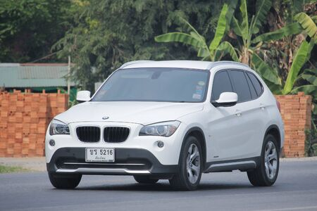 8 12: CHIANGMAI, THAILAND -MARCH 12 2016:    Private Car. Bmw X3. Photo at road no.1001 about 8 km from downtown Chiangmai, thailand. Editorial