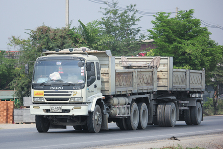 8 12: CHIANGMAI, THAILAND -MARCH 12 2016:   Trailer dump truck of Chiangmai Concrete product company, CCP. Photo at road no 121 about 8 km from downtown Chiangmai, thailand.