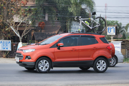 8   12: CHIANGMAI, THAILAND -MARCH 12 2016:   Private car, Ford Ecosport, Suv car for Urban User. On road no.1001, 8 km from Chiangmai city.
