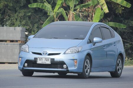 hybrid car: CHIANGMAI, THAILAND -MARCH 12 2016:   Private Hybrid car, Toyota Prius. Photo at road no.121 about 8 km from downtown Chiangmai, thailand.