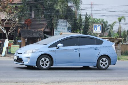 8   12: CHIANGMAI, THAILAND -MARCH 12 2016:   Private Hybrid car, Toyota Prius. Photo at road no.121 about 8 km from downtown Chiangmai, thailand.