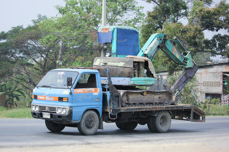 8   12: CHIANGMAI, THAILAND -MARCH 12 2016:   Truck and backhoe of Sor Company. On road no.1001, 8 km from Chiangmai city.
