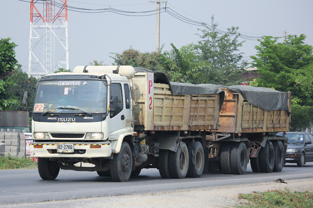 8 12: CHIANGMAI, THAILAND -MARCH 12 2016:  Trailer Dump truck of Sayjomthong Company. Photo at road no.121 about 8 km from downtown Chiangmai, thailand.