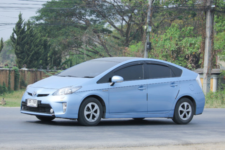 CHIANGMAI, THAILAND -MARCH 12 2016:   Private Hybrid car, Toyota Prius. Photo at road no.121 about 8 km from downtown Chiangmai, thailand.