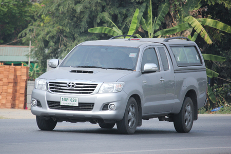 8   12: CHIANGMAI, THAILAND -MARCH 12 2016:   Private Pickup car, Toyota Hilux. Photo at road no 121 about 8 km from downtown Chiangmai, thailand.