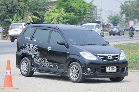 toyota: CHIANGMAI, THAILAND -MARCH 12 2016:   Private Toyota Avanza car. Mini Suv Car for Urbun User. Photo at road no.121 about 8 km from downtown Chiangmai, thailand.