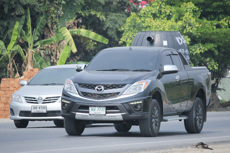 8 12: CHIANGMAI, THAILAND -MARCH 12 2016:   Private Pick up, Mazda BT50. Photo at road no.121 about 8 km from downtown Chiangmai, thailand.