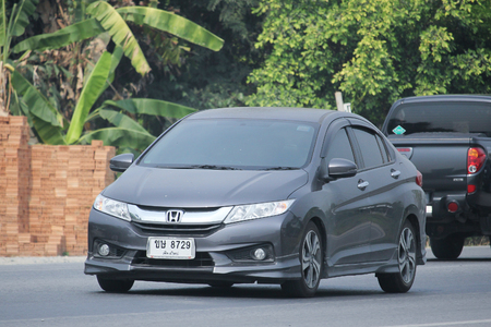 8   12: CHIANGMAI, THAILAND -MARCH 12 2016:   Private City Car, Honda City. On road no.1001, 8 km from Chiangmai city. Editorial