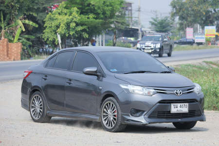 8 12: CHIANGMAI, THAILAND -MARCH 12 2016:  Private car, Toyota Vios. Photo at road no.121 about 8 km from downtown Chiangmai, thailand.