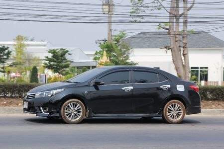 corolla: CHIANGMAI, THAILAND -MARCH 14 2016:   Private car, Toyota Corolla Altis. Photo at road no 121 about 8 km from downtown Chiangmai, thailand. Editorial