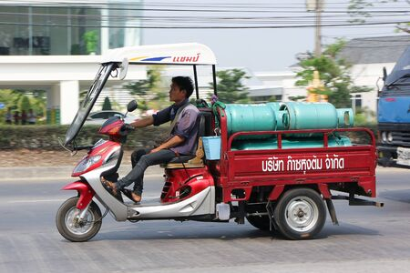 ngv: CHIANGMAI, THAILAND -MARCH 14 2016:  Motorcycle for delivery gas lpg to home of Champ Company. Photo at road no 121 about 8 km from downtown Chiangmai, thailand. Editorial
